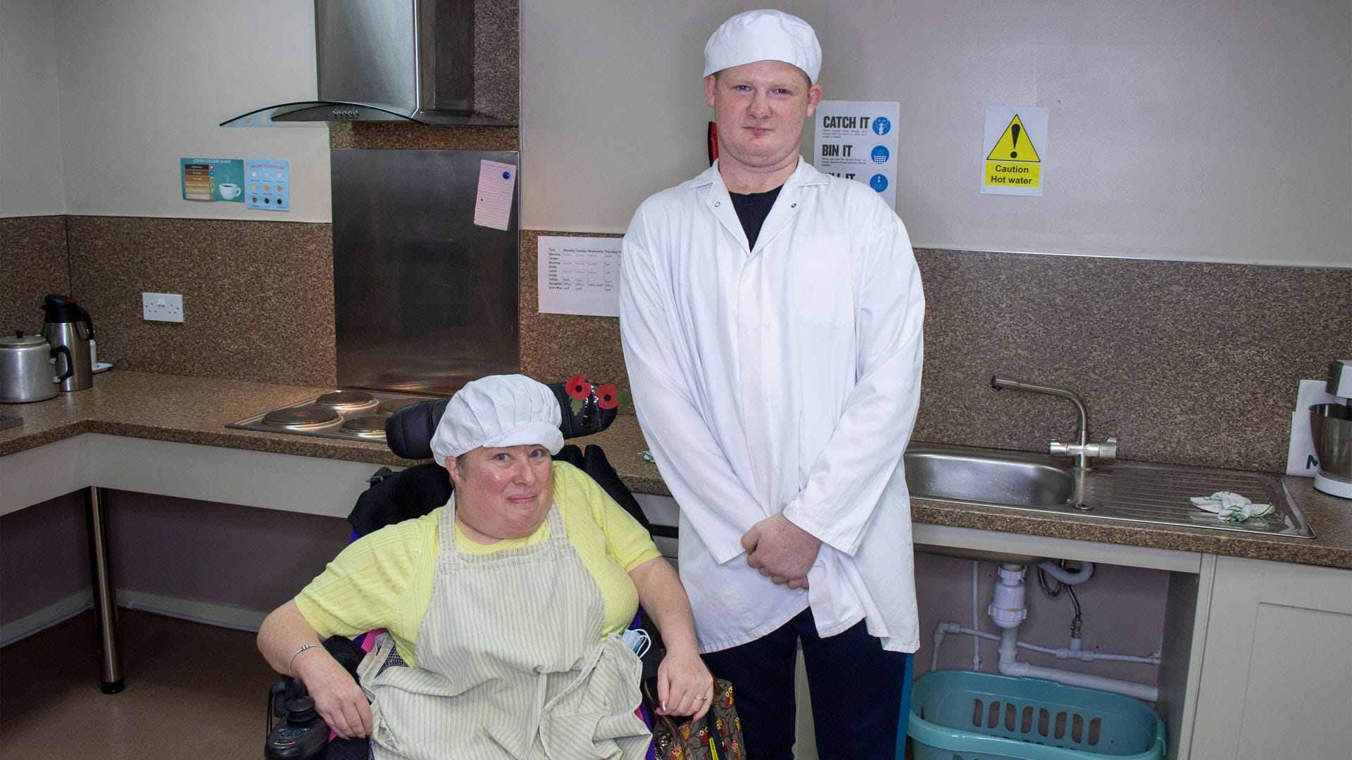 Two service users in the Magpies' kitchen