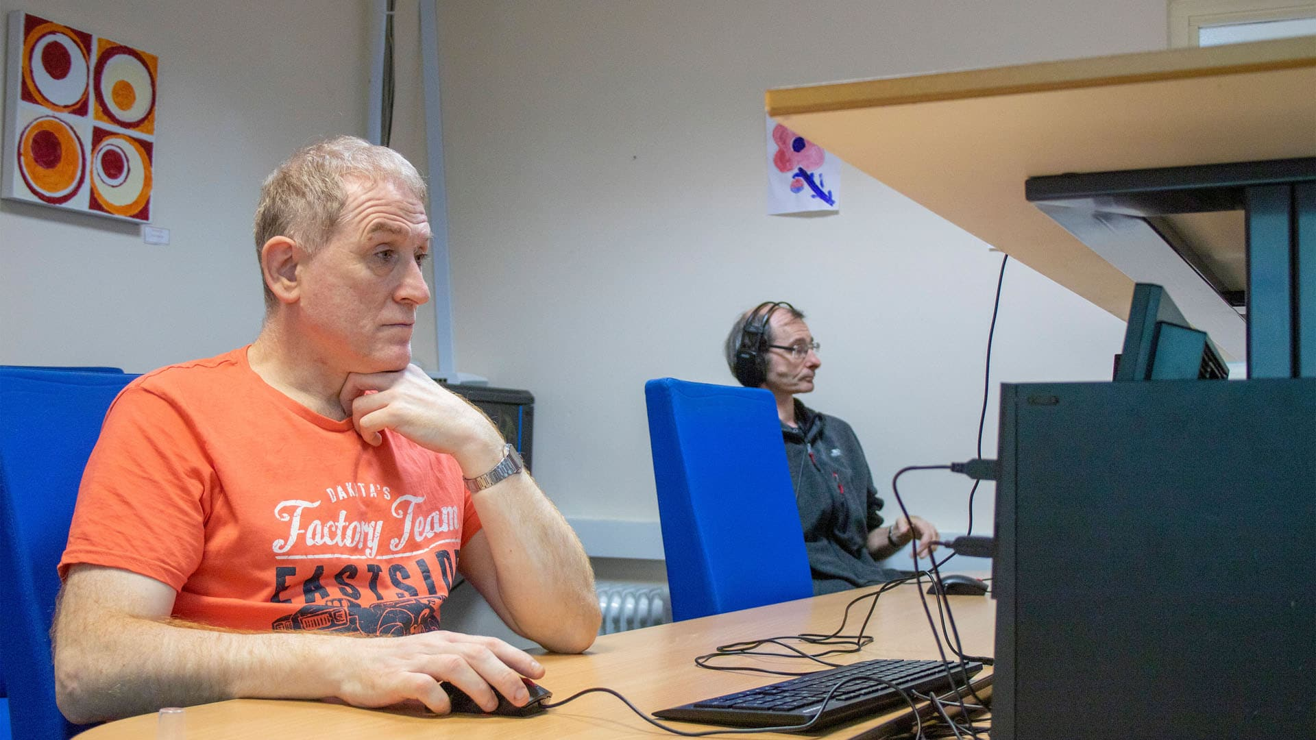 Two service users on PCs