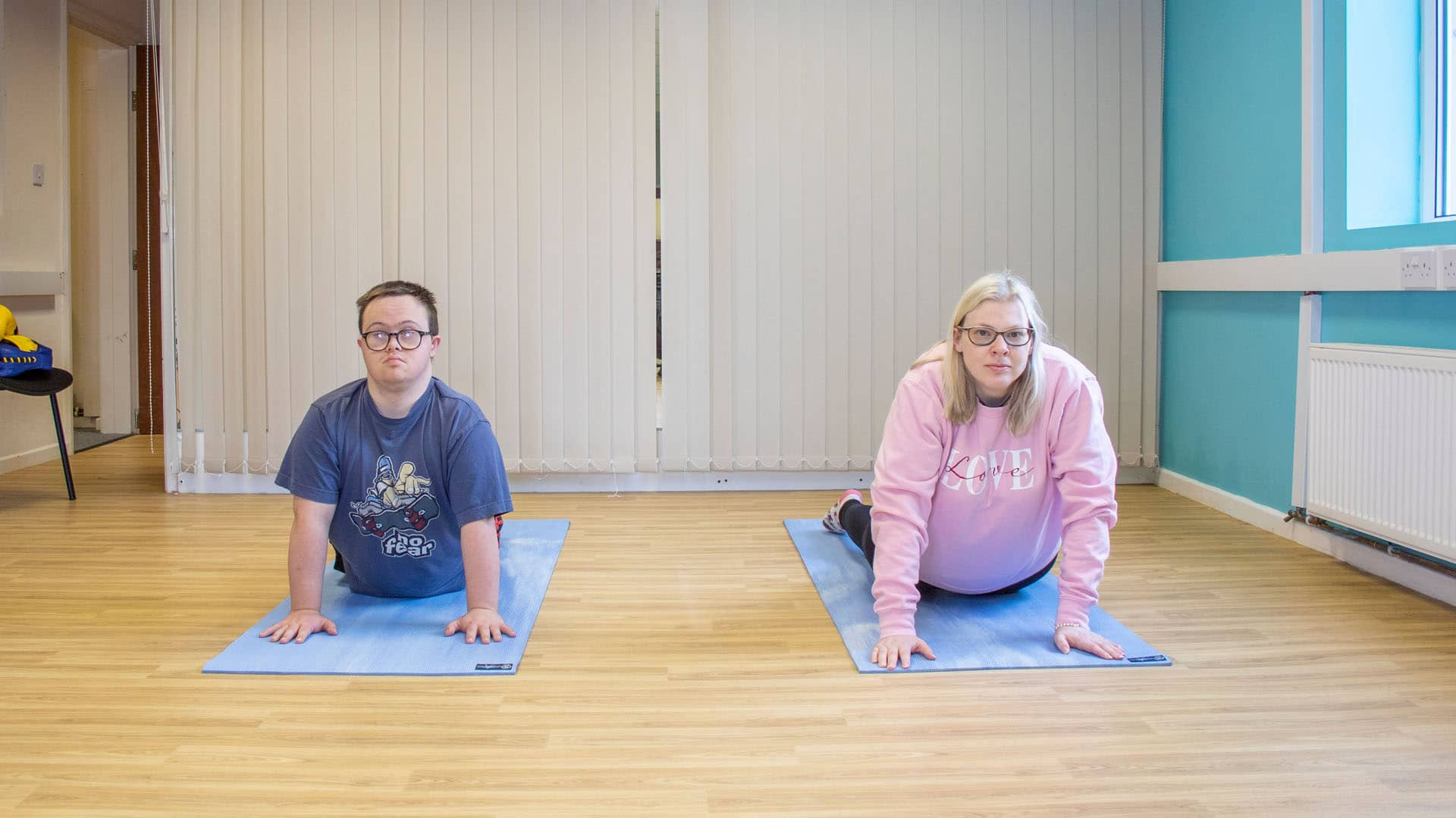 Service users doing yoga poses